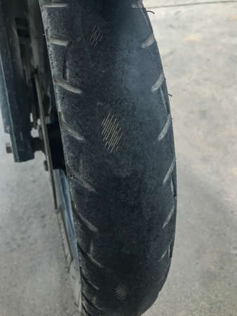 close up of expire old motorcycle tire rubber tile