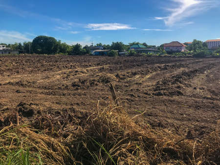 empty dirt field on sunny day at Thailand
