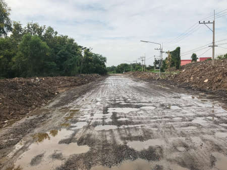 pile of dirt on dirty concrete road at thailand