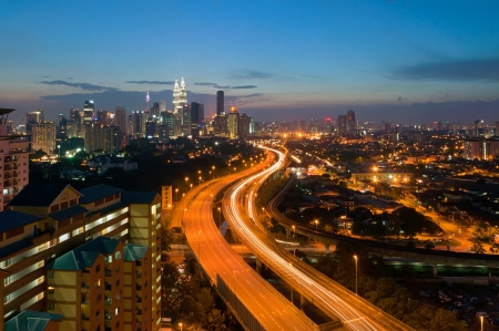 kuala lumpur tower: Scenery of twilight and busy elevated highway in Kuala Lumpur, Malaysia