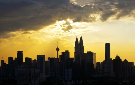 Silhouette of Kuala Lumpur city during sunset in Malaysia photo