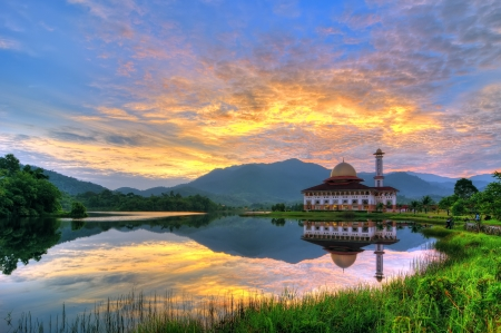 Reflection of a beautiful mosque by the lake side at dawn