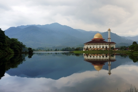 Reflection of a mosque in the morning by the lakeside
