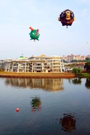 Putrajaya, Malaysia - March 29, 2013 - Two balloons from USA in flight at the 5th Putrajaya Hot Air Balloon Fiesta 2013