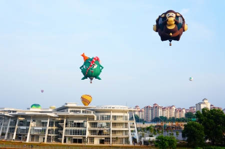 Putrajaya, Malaysia - March 29, 2013 - Variety shape of balloons in flight at the 5th Putrajaya Hot Air Balloon Fiesta 2013