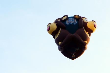 Putrajaya, Malaysia - March 29, 2013 - Monkeys shape balloon from USA in flight at the 5th Putrajaya Hot Air Balloon Fiesta 2013