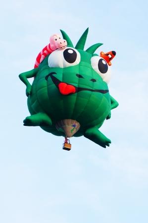 Putrajaya, Malaysia - March 29, 2013 - Green cartoon character shape balloon from USA in flight at the 5th Putrajaya Hot Air Balloon Fiesta 2013