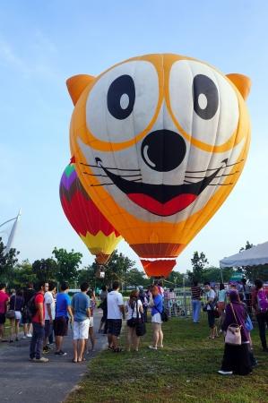Putrajaya, Malaysia - March 29, 2013 - Tethered hot air balloon rides for visitor at the 5th Putrajaya International Hot Air Balloon Fiesta 2013.