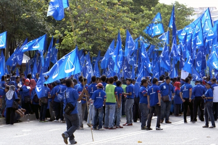PUTRAJAYA, MALAYSIA-APRIL 20,2013: Supporters of Barisan Nasional (BN) during candidate nomination day in Putrajaya, Malaysia.