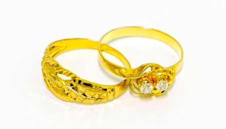 A pair of gold wedding rings isolated on white background Stock Photo