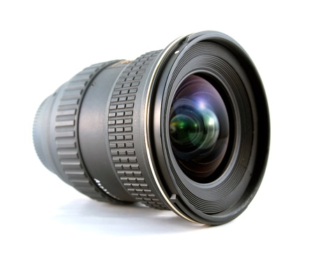 Ultra wide lens for SLR camera on white background photo