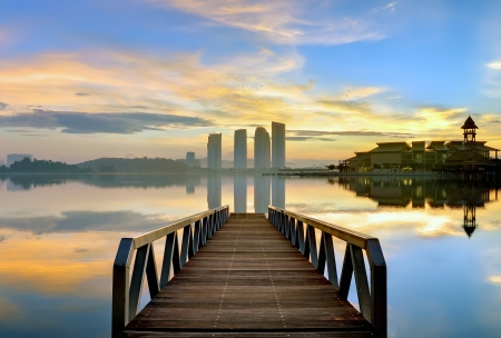 Landscape of wooden bridge at sunrise photo