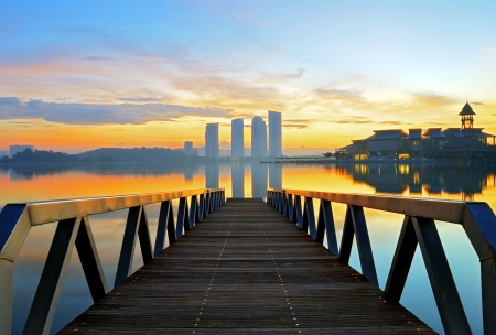 Landscape of wooden bridge at sunrise by the lakeside photo