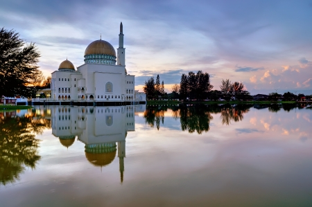 salam: As Salam mosque in the morning by the lakeside Stock Photo
