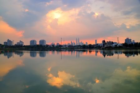 Reflection of Kuala Lumpur cityscape at sunset