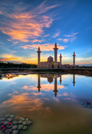 Reflection of a modern beautiful mosque at sunrise in Shah Alam, Malaysia  Stock Photo