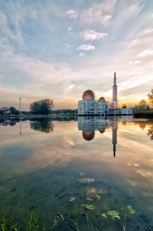 As Salam Mosque at sunrise with reflection in Puchong Perdana, Malaysia Stock Photo