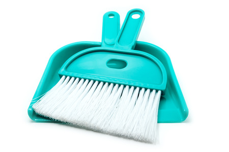Green dustpan with brush isolated on white background photo
