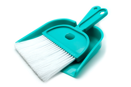Green dustpan and brush isolated on white background photo