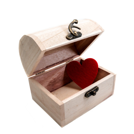 Red heart in wooden chest isolated on white background photo