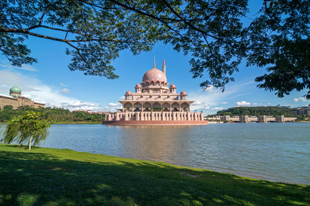 Putra Mosque in Putrajaya Malaysia during a blue sunny day