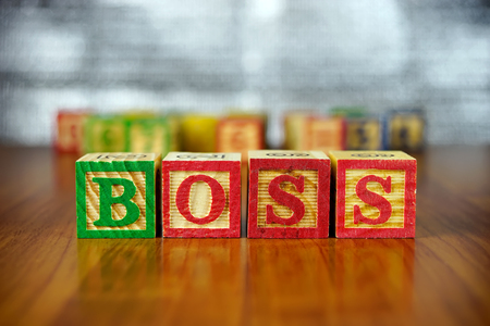 alphabet blocks: Word of BOSS spelled with colorful wooden alphabet blocks.