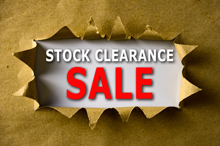 Torn brown paper with STOCK CLEARANCE SALE words