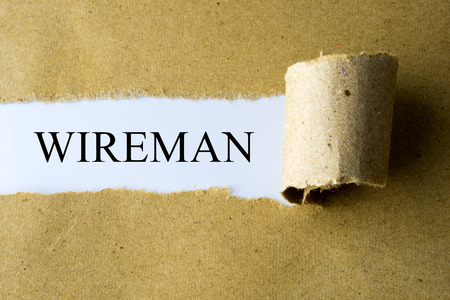 wireman: Torn brown paper with WIREMAN word. Stock Photo