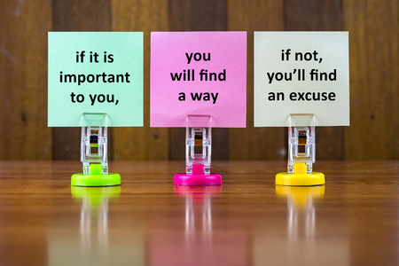 Word quotes of IF IT IS IMPORTANT TO YOU,YOU WILL FIND A WAY,IF NOT YOULL FIND AN EXCUSE on colorful sticky papers against wooden textured background. Stock Photo