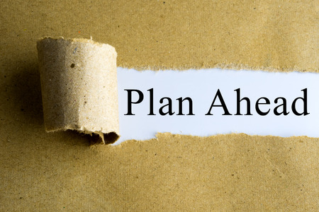 Torn brown paper with Plan Ahead words. Stock Photo