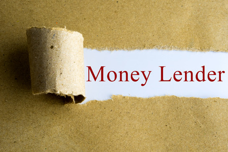 lender: Torn brown paper with Money Lender words. Stock Photo
