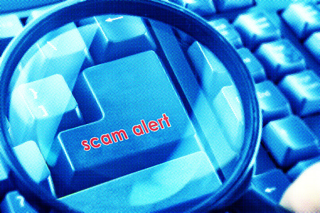fraudster: Magnifying glass on keyboard with Scam Alert word on button. Color halftone effect applied.