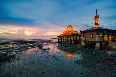 islamic scenery: Beautiful colorful sunset with mosque at the beach. Nature landscape.