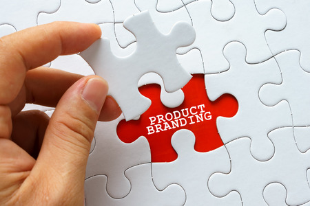 branded: White puzzle with word PRODUCT BRANDING