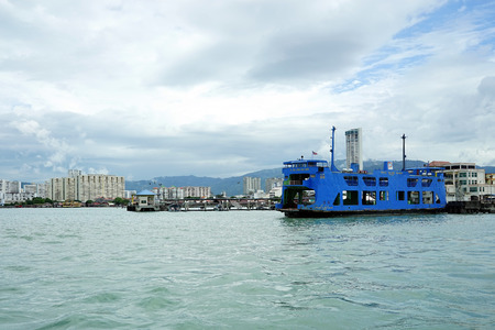 PENANG, MALAYSIA - JUNE 29,2017 : Penang ferry named as Pulau Talang Talang is one of the attraction in Penang, Malaysia. Beside the Penang Bridge, people also use the ferry service to cross from mainland to Penang Island.