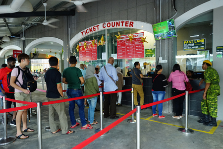 PENANG, MALAYSIA - JUNE 29,2017 : Tourist queueing to buy tickets at counters in Penang Hill, Malaysia. A famous tourism place among locals and foreign tourist.