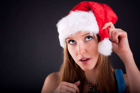 Christmas girl in the Santa Claus hat Stock Photo - 8383837