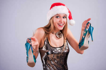 Christmas girl with shoes in hands photo