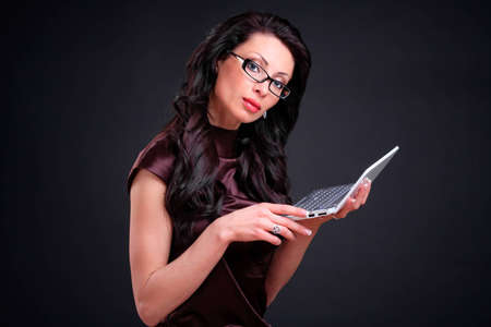 Business woman with a computer in hands photo