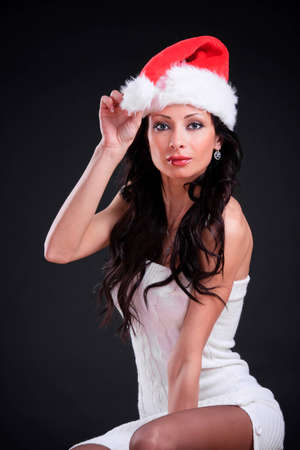 Sexy Christmas girl in the Santa Claus hat photo
