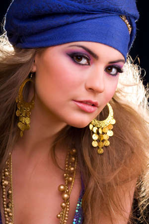 Beautiful girl in a turban and a stylized ethnic costume photo