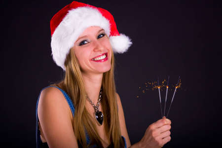 Cute girl in Santa hat holding sparklers Stock Photo - 8911109