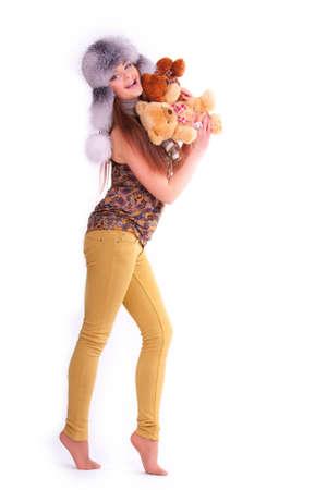 Beautiful longhair girl is holding the teddy bears photo