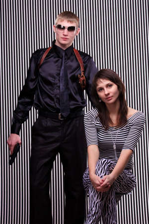 Young beautiful couple over stripe background photo