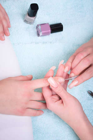 Manicure process with professional tools on female hand photo