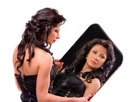 Beautiful young girl holding a large mirror photo