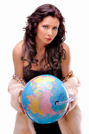 Beautiful woman with a globe isolated over a white background photo