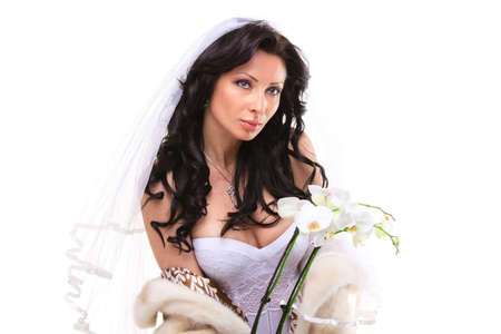 Studio portrait of a sexy brunette bride isolated on white background photo