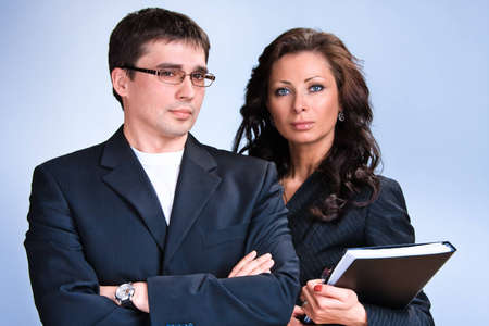 Portrait of young business people with documentations photo