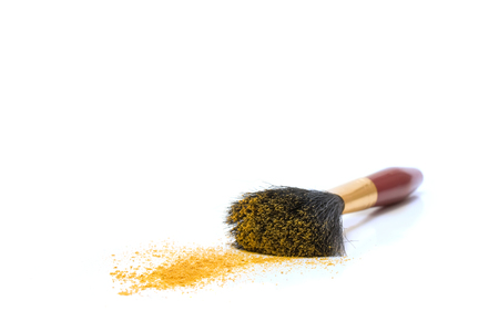 beautify: Brash and yellow powder.Isolated on white. Stock Photo